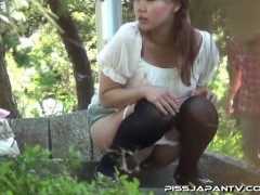 Adorable young hoochie caught pissing alfresco